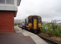 First train of the day, from Mallaig to Glasgow, on a misty overcast morning, calls at Banavie and is seen alongside the signalling centre. The guard rejoins 156456 before the train moves off for the next stop (and reversal) at Fort William. <br><br>[Mark Bartlett 19/05/2010]