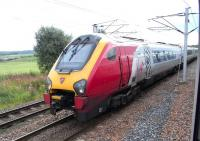An Edinburgh-bound Virgin Voyager between Carstairs South and East Junctions on 28 August 2010.  Photograped from a Glasgow Central - North Berwick Class 322, halted at signals east of Carstairs station to let it pass.<br><br>[David Panton 28/08/2010]