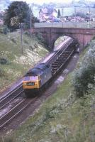 47056 running between Weston Rhyn and Chirk on the Shrewsbury to Chester line in June 1974 with a northbound train of what appear to be empty single bolster wagons. <br> <br><br>[Bill Jamieson 04/06/1974]