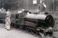 Two mini-enthusiasts admire the locomotive on the miniature railway (15' gauge?) that used to run along the western perimeter of the site at Steamtown, Carnforth, passing through the loco shed on the way.<br> <br><br>[Colin Miller //1979]