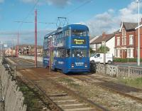 Rebuilt double-deck car 724 heads south from Cleveleys town centre on a service for Blackpool Pleasure Beach. The tracks here are on a reserved section in the middle of a dual carriageway but with several crossing points. [See image 22562] for the same location some eighteen months earlier when the line was closed for refurbishment.<br><br>[Mark Bartlett 16/10/2010]