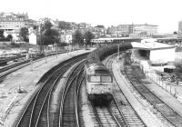 A 47 hauling oil tanks (probably empties) West through Newport in the dim and distant late eighties. Just out of shot to the right is the old goods yard see image [[30821]], which was later redeveloped as a shopping centre, while the bus station was revamped over half a mile away. No transport interchange planning there.<br><br>[Ken Strachan /08/1987]