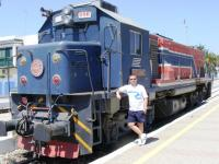 Railscot contributor Colin Harkins standing next to locomotive 550 556 at Bir Bou Regba station in Tunisia on 22 August 2010. This loco ran on 1m gauge track.<br><br>[Colin Harkins 22/08/2010]