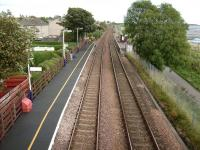 Looking east from the footbridge at Balmossie on 19 September 2007.  <br> The shortness of the platforms exaggerates the stagger.  If one platform were to warrant a shelter it would be the Dundee-bound one, but the tiny number of people each year catching the daily train the other way do at least get a bench.  For a picture of one of those trains a few years earlier [see image 16711].<br> <br><br>[David Panton 19/09/2007]