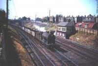 A class J37 0-6-0 passes Craigentinny signal box in the late 1950s heading south with a train of empties.<br><br>[A Snapper (Courtesy Bruce McCartney) //]