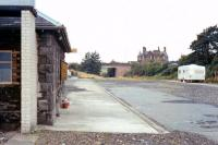 View from the Stranraer platform looking west at Castle Douglas in September 1973, some 8 years after closure. The trackbed has been infilled and one building remains at this stage (as a toilet block?). The former railway land here, which was put to a number of subsequent uses, is now occupied by a Tesco supermarket and its associated car park.<br><br>[Colin Miller /09/1973]