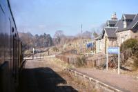 The level crossing and closed station at Achterneed seen from the 10.40 Inverness-Kyle train on Saturday 13th April 1968, as it battles into the 1 in 50 gradient towards the Ravens Rock summit. <br><br>[Frank Spaven Collection (Courtesy David Spaven) 13/04/1968]