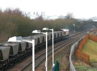 Westbound coal empties returning from Longannet to Hunterston rumble west through Camelon station, Falkirk, on 10 December 2004. The train is signalled for the route west at Carmuirs East Junction, just beyond the bridge.<br><br>[John Furnevel 10/12/2004]