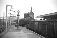45342 gets the road with a freight at the north end of Carnforth station in 1968.<br><br>[David Spaven //1968]