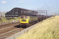 Brush Type 4 D1795 has just passed� Bowesfield signal box, standing at the eastern apex of the triangle of lines to the west of Tees Yard and south of Stockton. The train is a Teesport to Jarrow block oil working, photographed in October 1970. <br> <br><br>[Bill Jamieson 02/10/1970]