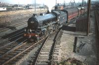 B1 no 61343 brings coaching stock destined for Waverley out of Craigentinny carriage sidings on 30 September 1959. Seen in the background, just above the B1's tender, is the tunnel inspection train [see image 27043].<br><br>[A Snapper (Courtesy Bruce McCartney) 30/09/1959]