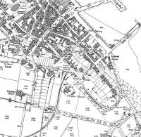 An extract from the 1899 map of Campbeltown showing the original terminus of the light railway, prior to the introduction of passenger services. At this time coal from the collieries between here and Machrihanish was probably the sole traffic. Later the railway was extended onto the quayside via reclaimed land on the foreshore. [See image 33469]<br><br>[Mark Bartlett //1899]