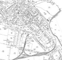 An extract from the 1921 map of Campbeltown showing the light railway now extended from the 1899 route [See image 33448] through a cutting and onto the town's quayside over reclaimed land. A triangular junction has also been created near the railway depot. By this time the passenger service had been operating for around fifteen years but within ten years from this date would cease following which the railway was dismantled. <br><br>[Mark Bartlett ../../1921]
