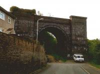If you need a house with a large external storage area, try Central Street in Ener'glyn, on the North side of Caerphilly. This dramatic arch, which dwarfs the 17-seat minibus below, is all that remains of the Barry Railway viaduct. The BR was known to staff of rival companies as 'the spoilt child of Parliament' - like the GCR, it arrived last and closed first, surviving for only 40-odd years during the peak of coal production in the Rhondda. So this viaduct was used for 45 years, but has been derelict for 73. Sad. The Valley line to Caerphilly passes to the left of this arch; there is a plan to build a new station here. <br><br>[Ken Strachan 31/05/2010]