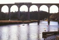 A 2-car DMU bound for Gunnislake crosses the Tamar on Calstock Viaduct in January 1990. The viaduct, built in 1908, carries the railway 120 feet above the river between Bere Alston and Calstock.<br><br>[Ian Dinmore 15/01/1990]