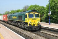 Freightliner 66543 brings an eastbound container train through Cholsey on 21 April 2011.<br><br>[Peter Todd 21/04/2011]