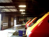 A lineup of Voyagers inside the shed at Central Rivers Depot, Burton on Trent, on 24 April 2011. Seen from the BLS special <I>Another Trent Explorer</I>, which ran through the shed on the tilt test line. [See image 33912]<br><br>[Ken Strachan 24/04/2011]