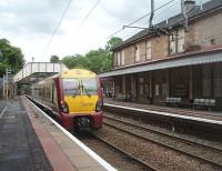 334017 pulls away from Bearsden heading along the short double track section to Hillfoot that sits in the middle of the mainly single track Milngavie line. This <I>dynamic loop</I> allows an intensive service to be operated on the branch. The original station building is now a pub/restaurant and the small modern ticket office and waiting room is just beyond it on the Up platform.<br><br>[Mark Bartlett 25/05/2011]
