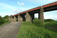 The western end of the long viaduct that spanned the Monkland Canal at Calder, between Whifflet and Airdrie, seen here in June 2011. The line, which closed in 1990, latterly served the Imperial Tube Works. <br><br>[John Steven 10/06/2011]