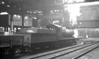 Ex-GWR 3808 takes an up goods train through Birmingham Snow Hill station in October 1964.<br><br>[K A Gray 22/10/1964]