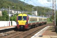 A Helensburgh Central to Edinburgh Waverley service photographed on 30 May 2011 passing non-stop eastbound through Bowling station. <br><br>[John McIntyre 30/05/2011]