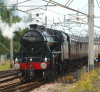 Black 5 no 45305 sets off from a watering stop at Carnforth on 23 July 2011. The train is the <I>'Cumbrian Mountain Express'</I> railtour from Crewe to Carlisle, via Liverpool Lime Street.<br> <br><br>[John McIntyre 23/07/2011]