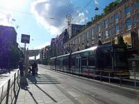 A tram passes Stockholm's famous department store NK on Hamngatan on a beautiful late afternoon in July.<br><br>[Beth Crawford 24/07/2011]