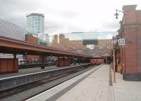 The reopened and restored bay platforms at Moor Street station, looking towards the buffers in June 2011. The attention to period detail throughout the renovation of this busy commuter station is striking. The <I>Bull Ring</I> tower in the background overlooks the south end of Birmingham New Street and illustrates how close to each other the two stations are situated. [See image 48181] for the same scene ten years earlier.<br><br>[Mark Bartlett 08/06/2011]