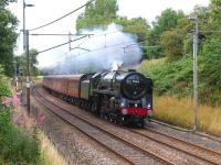 Running south towards Barton and Broughton on the WCML on 15 August 2011, Britannia Pacific no 70013 <I>Oliver Cromwell</I> makes easy work of <I>The Mersey Moorlander</I> with its 12 coach load. <br><br>[John McIntyre 15/08/2011]