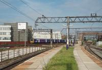 Looking across to the LNWR lines from Ardwick's deserted platforms, situated on the old Great Central route. Northern EMU 323237 is approaching Ardwick junction (where the two companies met) on a suburban service for Manchester Piccadilly. <br><br>[Mark Bartlett 03/08/2011]