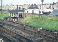 Removing a trespasser from the East Coast Main Line alongside Craigentinny signal box in September 1958. (<I>Presumably on the lookout for 60021</I>) (Editors note: Please [see image 29099] to reduce e-mails!)<br><br>[A Snapper (Courtesy Bruce McCartney) 27/09/1958]