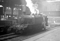 Collett 2-6-2T no 8109 potters around in the shadows at Birmingham Snow Hill on 22 October 1964, some 8 months before withdrawal from nearby Tyseley shed. On the adjacent line Churchward 2-8-0 3808 is passing through the station with an up goods train [see image 34443].<br><br>[K A Gray 22/10/1964]