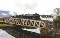Black 5 no 44871 eases slowly across the swing bridge at Banavie with <I>The Jacobite</I> on 13 October 2011.<br> <br><br>[John Gray 13/10/2011]
