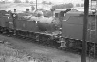Johnson Midland 0-6-0T no 41875 photographed on Canklow shed in May 1961. The locomotive moved to Barrow Hill 3 months later and ended her operational days there in July 1963.<br><br>[K A Gray 27/05/1961]