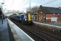 380 013 draws to a stop at Bishopton with a Glasgow bound service on 27 November.<br><br>[Ewan Crawford 27/11/2011]
