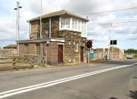 The ECML level crossing and signal box at Chathill, Northumberland, photographed looking east towards the coast in August 2007. [See image 21832] <br><br>[John Furnevel 16/08/2007]