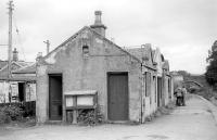 Closed to passengers in 1965, Aberlour station building is seen here on 14 October 1978, complete with weighing machine, noticeboards and GENTLEMEN sign still in place [see image 36839]. <br> <br><br>[Bill Roberton 14/10/1978]