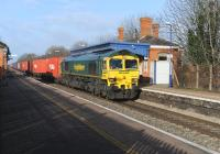 Freightliner 66535 passing eastbound through Cholsey Station on 5 January with a container train.<br><br>[Peter Todd 05/01/2012]