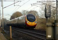 A southbound Pendolino rushes towards Carnforth past Yealand Steps on 28 January 2012.<br><br>[John McIntyre 28/01/2012]