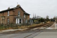 Barton Hill has been closed since 1930, like most other intermediate stations between York and Scarborough. It is still in use as a private house alongside the line, as seen in this view from the level crossing towards York.<br><br>[Mark Bartlett 02/02/2012]