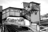 View west towards Dundee from Gray Street level crossing, Broughty Ferry, in March 1993. Note the door built into the covered footbridge providing access to the signal box stairway.<br><br>[Bill Roberton /03/1993]
