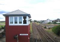 Looking south from the footbridge over the level crossing at Carnoustie in August 2006 towards the site of the original 1838 station, replaced in 1900 by the current structure, located on the north side of the crossing behind the camera.<br><br>[John Furnevel 12/08/2006]