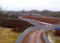 Work continues on the North Chord embankment at Nuneaton on 12 February 2012 as an up Pendolino storms past on the WCML in the background. See image [[36137]]<br><br>[Ken Strachan 12/02/2012]