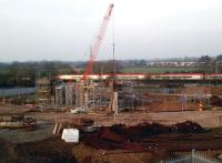 The setting sun lights up a down Pendolino on 2 March 2012 as it passes ongoing work on the accommodation bridge at Stoney Road that will form part of the Nuneaton North Chord.<br><br>[Ken Strachan 02/03/2012]
