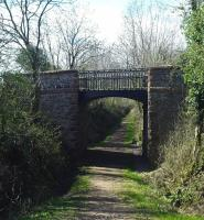 Cast-iron overbridge at Lodge of Kelton in April 2012 looking towards Kirkcudbright - now bypassed by a loop in the road over the infilled cutting. <br><br>[Colin Miller 01/04/2012]