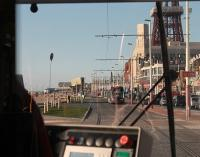 View over the shoulder of the driver of a new <I>Flexity</I> tram on Blackpool Promenade on Day 2 of the new services. It is a warm spring evening and a sister unit is heading for Starr Gate as this Fleetwood bound tram approaches the Tower. Some of the recent improvements to the promenade can also be seen.  <br><br>[Mark Bartlett 05/04/2012]