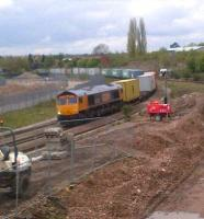 GBRf 66715 <I>Valour</I> passes construction works for Nuneaton's North Chord as it heads East with containers on Saturday lunchtime, 5 May 2012.<br><br>[Ken Strachan 05/05/2012]