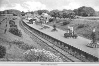 Old postcard showing the station at Alloway. View is to the east from just by the tunnel - probably from the footbridge (which collapsed in 1948 under the weight of the passengers on the Troon Old Parish Church Sunday School Trip). The station cottages can be seen on the right - their address is still Station Cottages. The high level goods yard is now the site of the new Burns Heritage Museum.<br><br>[Colin Miller Collection //]