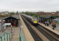 A May 2012 Sunday evening at Brough sees Hull Trains <I>Adelante</I> unit 180111 call on a service bound for Kings Cross. During the same week the nearby aircraft factory received the welcome news of a new contract for Hawk jets from Saudi Arabia. Brough station dates from 1840 and trains formerly ran on both sides of the two island platforms. <br><br>[Mark Bartlett 20/05/2012]