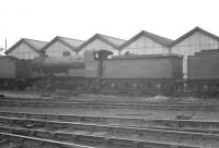 J6 0-6-0 no 64277 stands on Copley Hill shed (56C), Leeds, thought to be in the early 1960s. The locomotive was officially withdrawn from here in June 1962. <br><br>[K A Gray //]